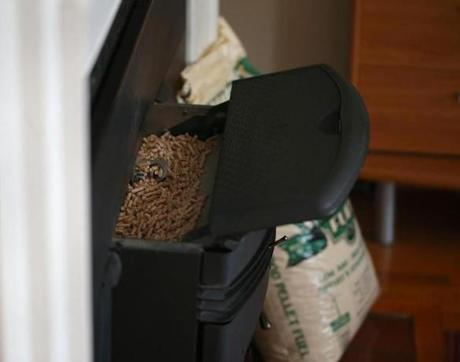 Ni's stove burns one 40-pound bag of wood pellets a day in the heating season; the latest annual delivery cost $640.